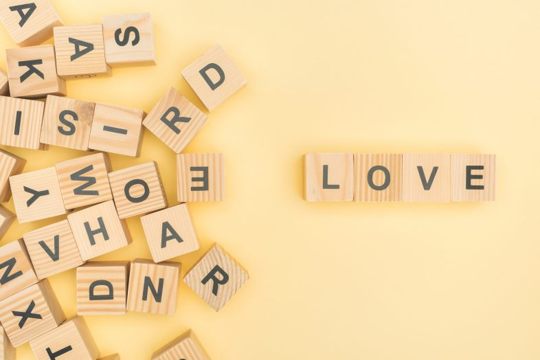 the letters L-O-V-E in scrabble blocks