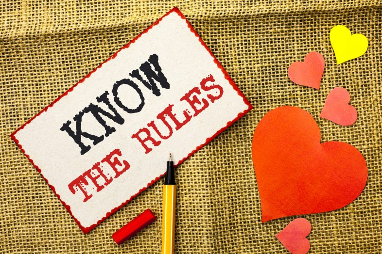 Handwriting text Know The Rules. Concept meaning Be aware of the Laws Regulations Protocols Procedures written Sticky Note Paper by Pointer the jute background Love Hearts next to it.