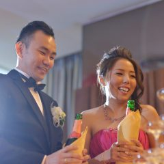 Happy Asian Chinese wedding dinner reception, bride and groom champagne toasting, natural candid photo.